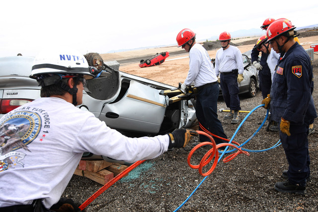The Nevada Urban Search & Rescue Task Force during a rescue drill in 2013. FEMA-designated disaster response team will be involved in a large scale Nevada/California earthquake preparedness dr ...