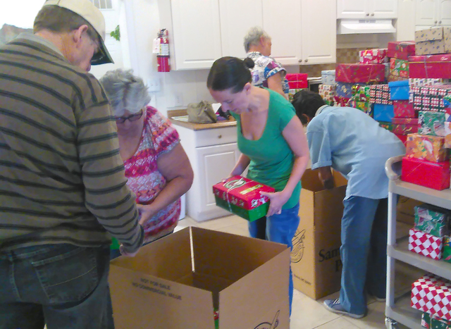 Trinity Assembly of God church volunteers began packing hundreds of shoe boxes filled with supplies for poverty-stricken children around the world. More than a half dozen churches in Pahrump are p ...