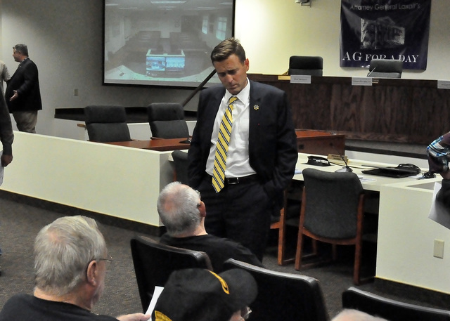 Horace Langford Jr. / Pahrump Valley Times  Attorney General Adam Laxalt chats with Pahrump local during a visit in September. Laxalt said a public-private partnership to help active duty military ...