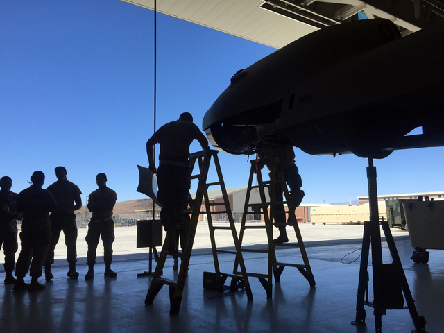 Airmen assemble the airframe for an MQ-9 Reaper remotely piloted aircraft in June 2015 inside a hangar at Creech Air Force Base, 55 driving miles northeast of Pahrump.  Keith Rogers/Special to the ...