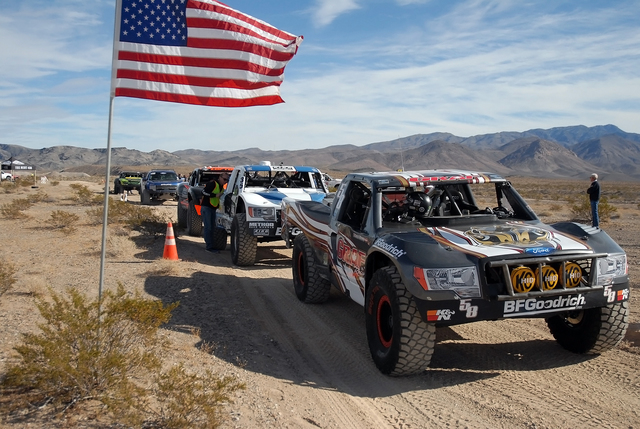 Trick trucks line up at the time trials on Thursday for the Pahrump Nugget 250. There will be nearly 150 racers for Saturday's race, which starts in Johnnie at 8 a.m. There will be a 16-mile par ...