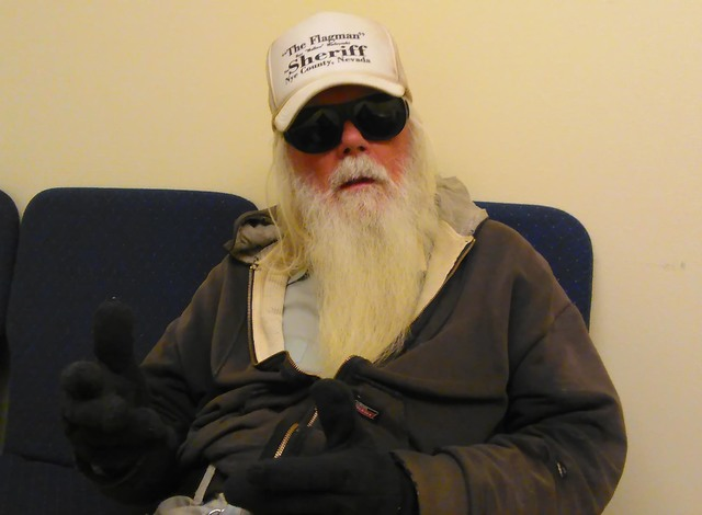 """Though he sports a long white beard, Ray """"The Flagman"""" Mielzynski insists he's not Santa Claus even though he offered to pay a $6,000 fine for convicted felon Anthony Greco this week. Judge  ..."""