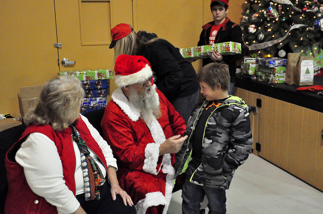 Santa chats with Blake Donnely during the NyE Communities Coalition's Community Christmas dinner last year. This year's event is Sunday, noon to 3 p.m., at the coalition's location at 1020 E ...