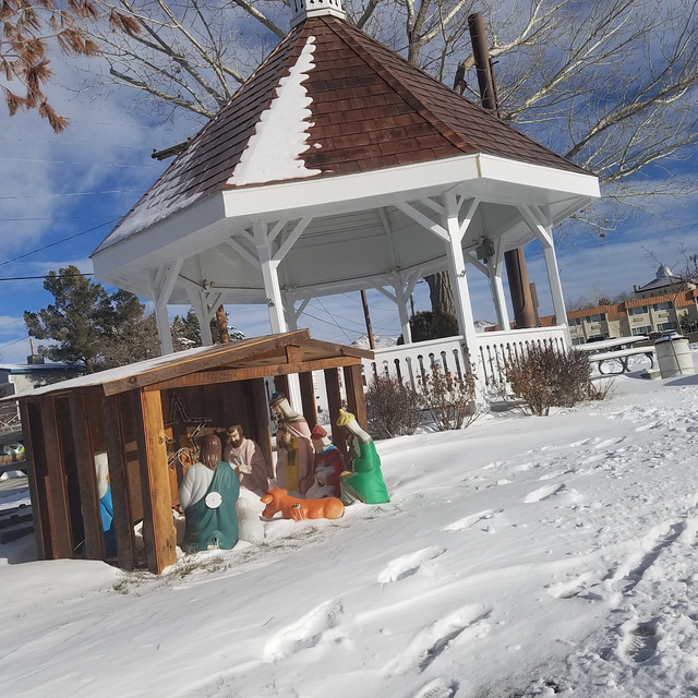 Snow, as shown in downtown Tonopah on Dec. 24, hours after the storm moved through, making for a white Christmas in town. The photo shows snow near a nativity scene and gazebo on Main Street near  ...