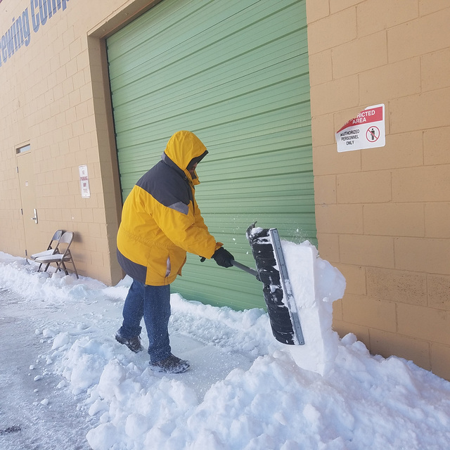Brian Sachs is shown shoveling snow in Tonopah on Dec. 24 after a storm moved through, making for a white Christmas in town. Roads were snowy and slick in spots. The storm dropped 8 inches of snow ...