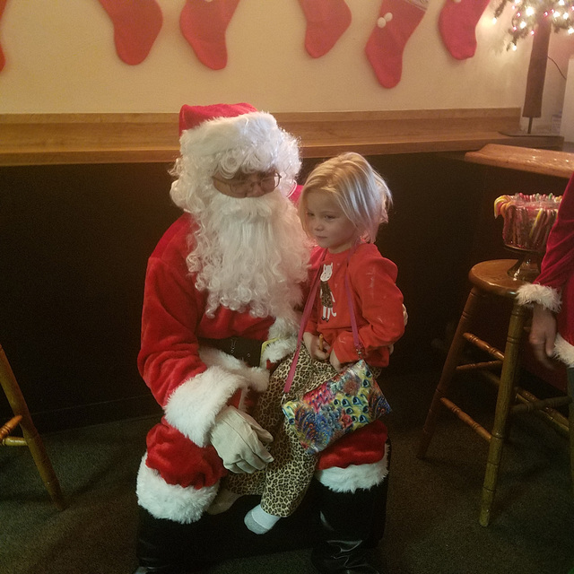 Santa visits with Brynlee Frazier, 5, during a kids' Christmas party on Dec. 24 inside the Tonopah Liquor Company. David Jacobs/Times-Bonanza & Goldfield News