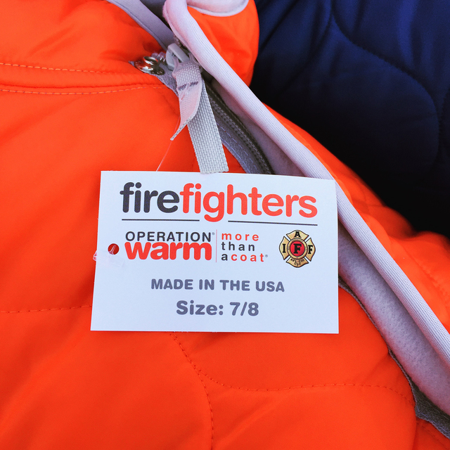 Each coat has a tag on the outside that says it was made in America, and inside there's a tag for the child to write their name.  Special to the Pahrump Valley Times