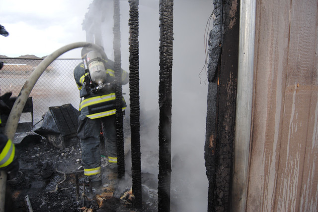 Fire crews extinguish a structure fire on the 2800 block of Bannavitch Street last Friday. The fire broke out in an accessory building on the property, which was home to more than 100 animals. No  ...