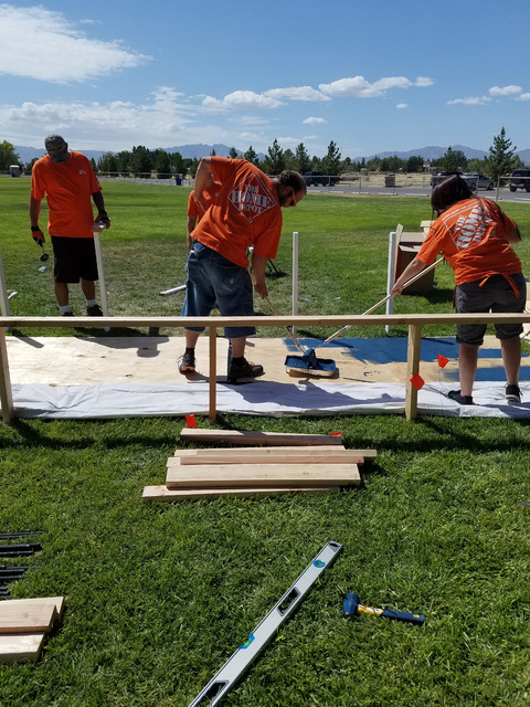 Home Depot employees work on the moving Vietnam wall's walking path at Simkins Park prior to the opening of the memorial during the weekend of the Pahrump Fall Festival. The Home Depot Foundatio ...