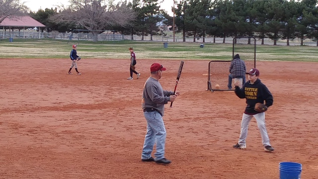 Charlotte Uyeno / Pahrump Valley Times Major Division Diamondbacks Manager, Jason Sandoval gets the old fungo bat out for practice.