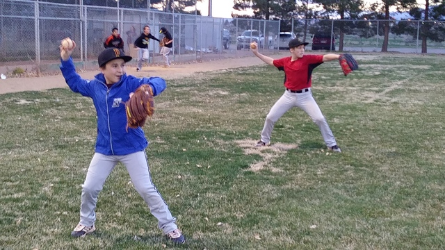The temperature is still cold and the grass is barely greening but baseball is back. Junior Division Angels start practicing with brothers, Scott (blue jacket) and Perry (red shirt).  Charlotte Uy ...
