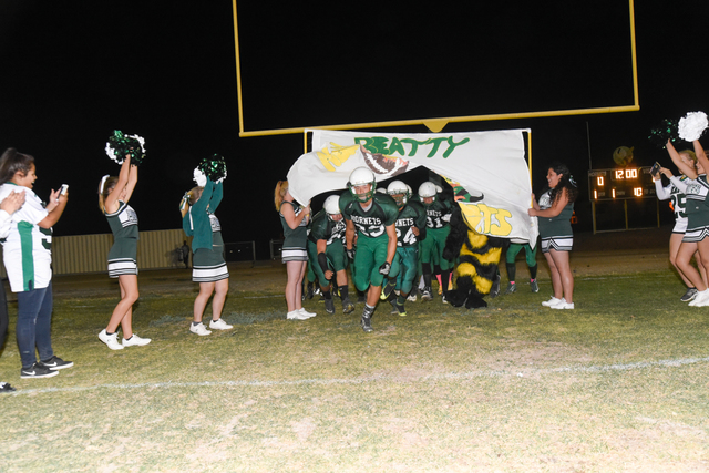 Skylar Stephens / Special to the Pahrump Valley Times Max Taylor leads the team onto the field as the Hornets hit the field for their last home game of the season against Round Mountain. Beatty wa ...