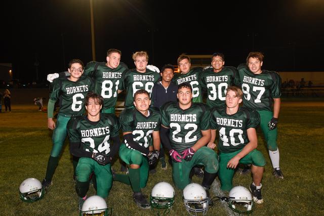 Beatty football high seniors from left to right, back row: Nahum Favela, Jake Ybarra, Robby Revert, Jhon Paul Adajar, Isais Femat, Mariano Villa. Front row, from left to right: Matthew Reetz, Jaco ...