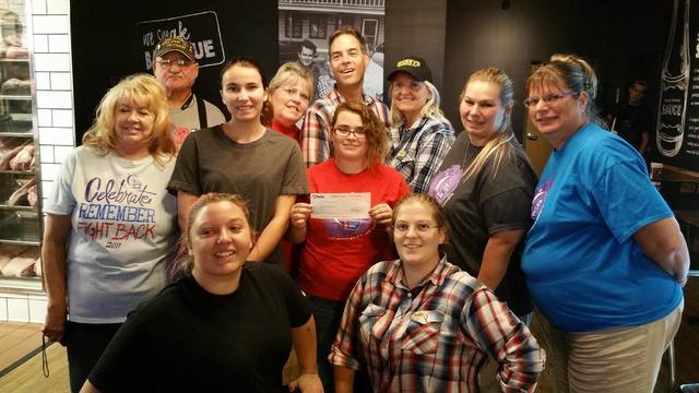 Members of Pahrump's Relay For Life organization accept a check from Dickey's Barbecue Pit Owner Doug Dubin, rear center, and staff following a fundraiser this month at the restaurant. Relay F ...