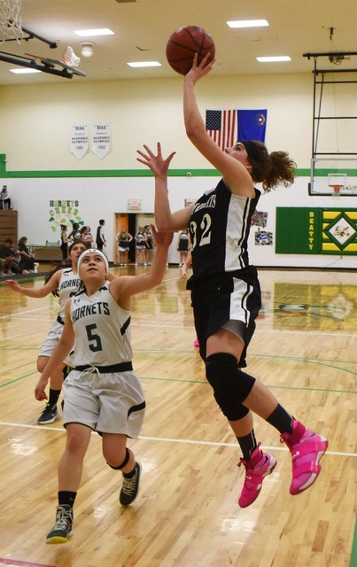 Lexi Gil (5) tries to keep Round Mountain's top scorer, Alyssa Hanks, from scoring on Feb. 10. Gil is the top player for the Hornets and she knows her hands will be full against Round Mountain t ...