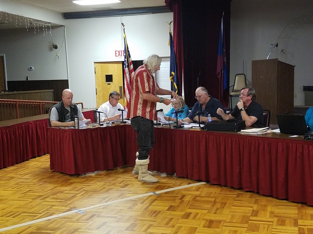 Durk Pearson, standing, hands out a map to the Tonopah Town Board as shown in this Oct. 26 photo. The board is working on a grazing exemption to reassure ranchers as the result of an annexation ap ...