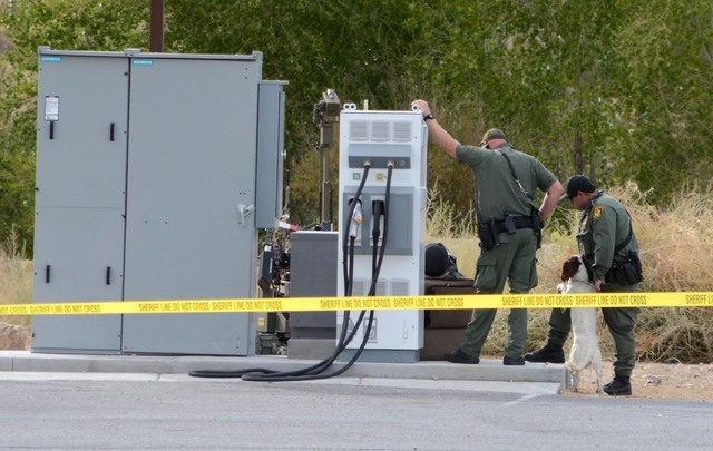 The area around Eddie World Gasoline in Beatty was cleared out Monday morning after a suspicious suitcase was found next to an electric car charging station, according to the Nye County Sheriff' ...