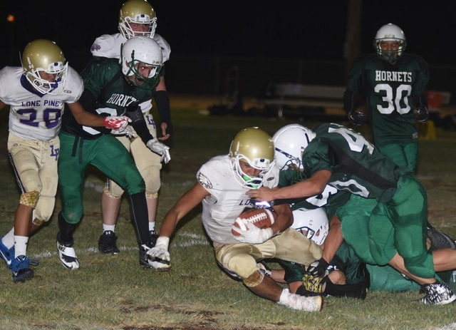 Richard Stephens / Pahrump Valley Times The Beatty defense stops Lone Pine in its tracks on Friday. Big defensive plays helped the Hornets seal the win.