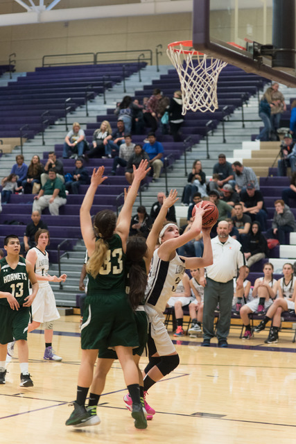 Alyssa Hanks works for a shot against Claudia Granados (33) on Friday at Sunrise Mountain. Hanks scored 28 points. The Lady Hornets could not shut down the combo of Hanks and Hannah Swafford; the  ...