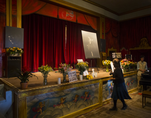A woman looks at a photo during a celebration of life for Marta Becket at the Amargosa Opera House, which she started in the 1960s, in Death Valley Junction, Calif. on Friday, Feb. 10, 2017. Becke ...