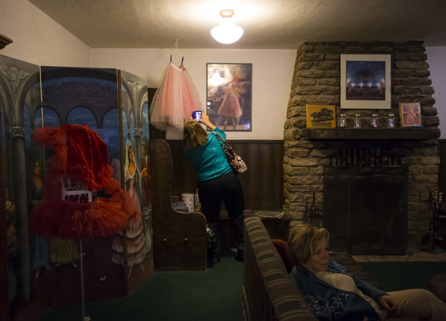 A woman takes a photo in the lobby of the Amargosa Opera House and Hotel following a celebration of life for Marta Becket in Death Valley Junction, Calif. on Friday, Feb. 10, 2017. Becket passed a ...