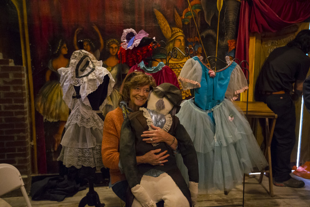 Jan Broderick poses with a doll used in performances following a celebration of life for Marta Becket at the Amargosa Opera House, which she started in the 1960s, in Death Valley Junction, Calif.  ...