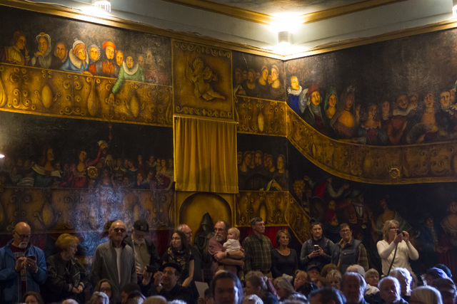 People line up against the famously painted walls during a celebration of life for Marta Becket at the Amargosa Opera House, which she started in the 1960s, in Death Valley Junction, Calif. on Fri ...