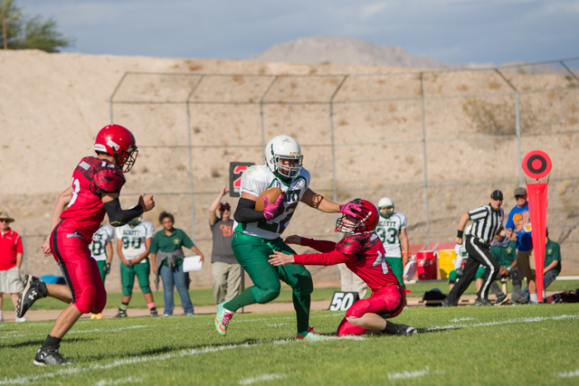 Hugo Mendoza breaks a tackle against Beaver Dam two weeks ago. Spring Mountain will have to stop the Hornets' running game to win.  Skylar Stephens / Special to the Pahrump Valley Times