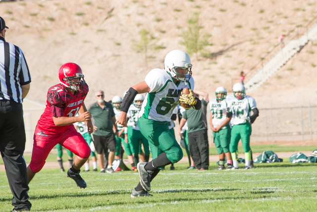 Skylar Stephens / special to the Pahrump Valley Times Robby Revert runs the ball in a rare moment against Beaver Dam.