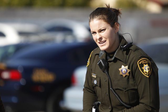 Metropolitan Police Department officer Nicole Hemsey wears a body camera in this 2014 file photo. A state Senate bill would require such cameras for all peace officers who interact regularly with  ...