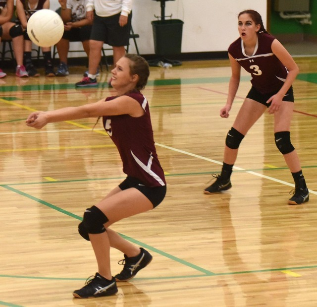 Richard Stephens / Pahrump Valley Times Breeana Marten gets a bump playing the Hornets on Sept. 6.