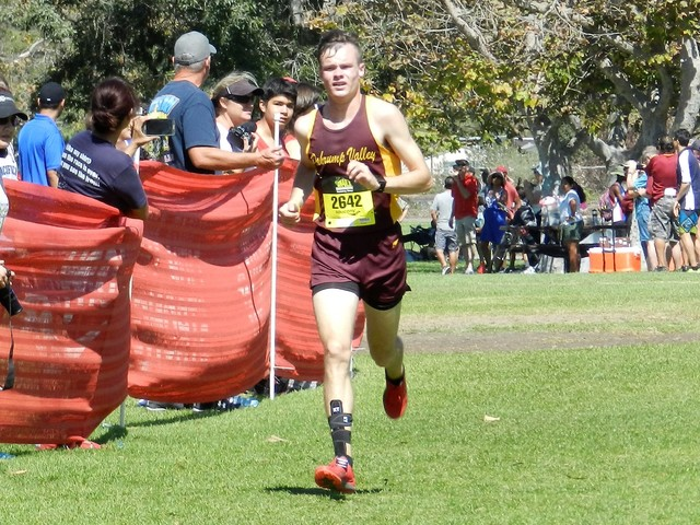 Special to the Pahrump Valley Times Above, Bryce Odegard runs at an invite in Huntington Beach. He is one of the reasons the boys are doing so well in cross-country. He is their best runner and is ...