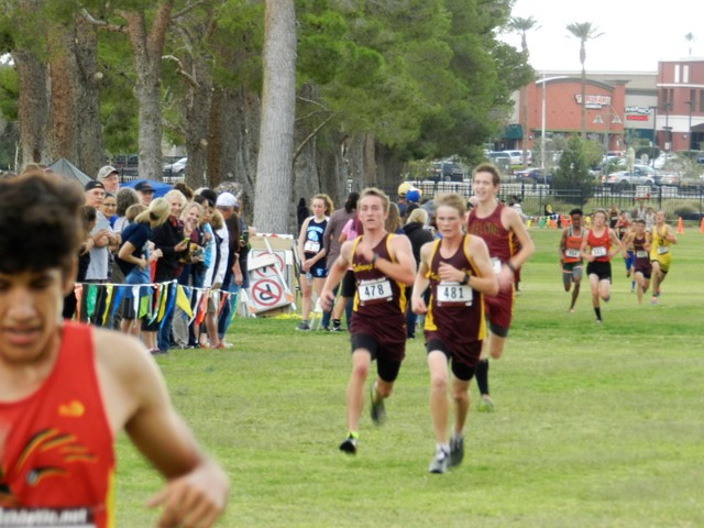 Special to the Pahrump Valley Times Cole Goodman and Grant Odegard fight for 12th place and 13th place at 3A Southern Region meet on Friday at Craig Ranch Park.
