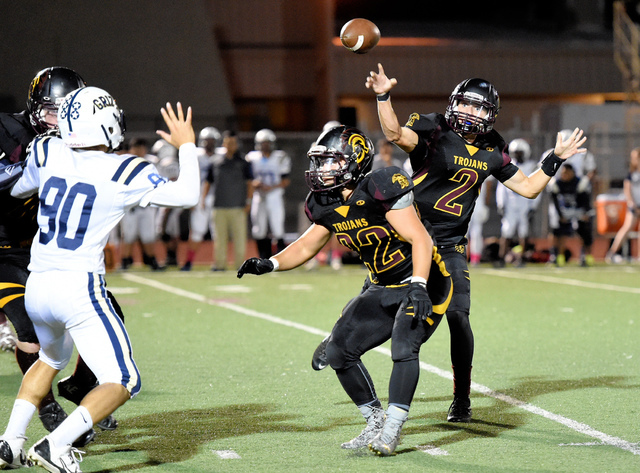 """Peter Davis / Special to the Pahrump Valley Times Peter Davis was the winner of this year's """"Best Sports Photo"""" contest. The picture shows former Trojans QB throwing against Spring Valley last sea ..."""