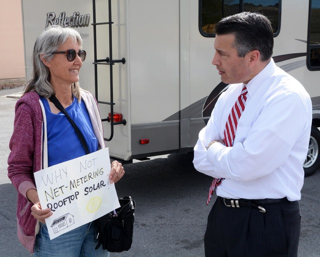 Governor Sandoval speaks with Beatty resident Laura Cunningham about her concerns regarding changes in policy by Nevada Power that have made it more difficult for homeowners to install and own roo ...