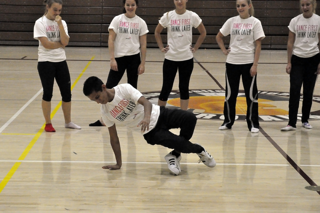 Horace Langford Jr. / Pahrump Valley Times   Chris Geer shows off some break dance moves during practice while his teammates cheer him on. Geer got his start in dancing as a break dancer.