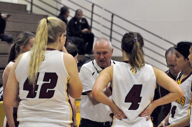Coach Bob Hopkins discusses tactics with his team during a timeout. Horace Langford Jr. / Pahrump Valley Times