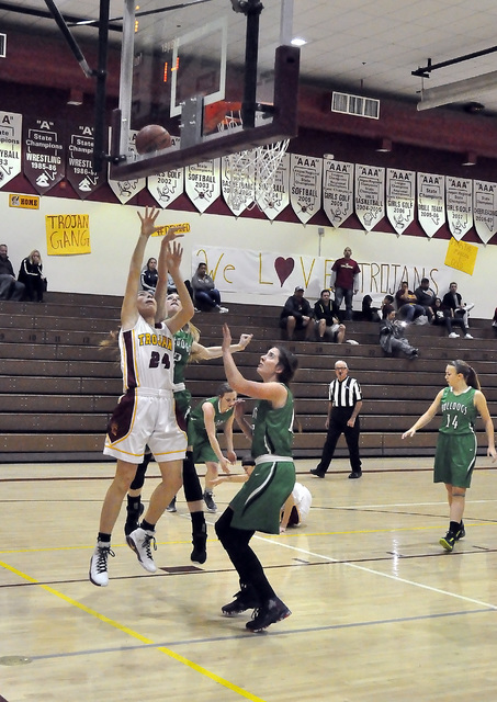 Horace Langford Jr. / Pahrump Valley Times 24 Helen Vann completes a shot against the Bulldogs on her way to a 12 point night.