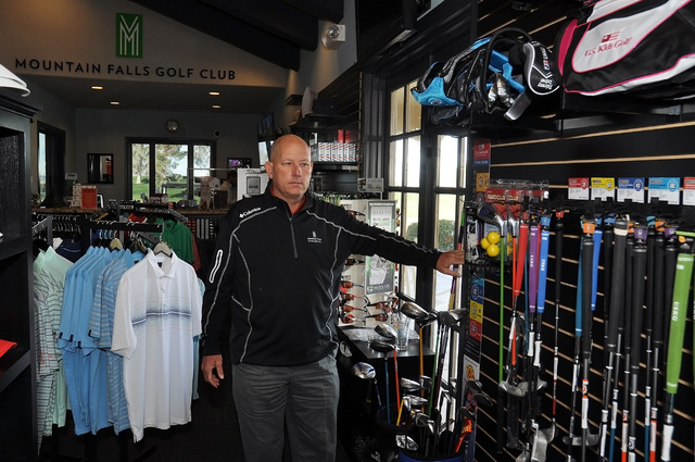 Horace Langford Jr. / Pahrump Valley Times  Golf professional Randy Mudge shows off an array of clubs at Mountain Falls.