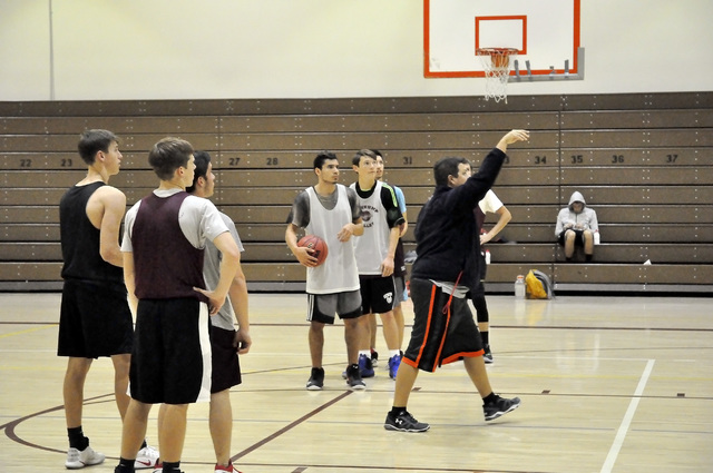Horace Langford Jr. / Pahrump Valley Times  Assistant basketball coach James Taylor talks to the varsity boys. One thing about coaching with the high school is he spends more time with his father, ...