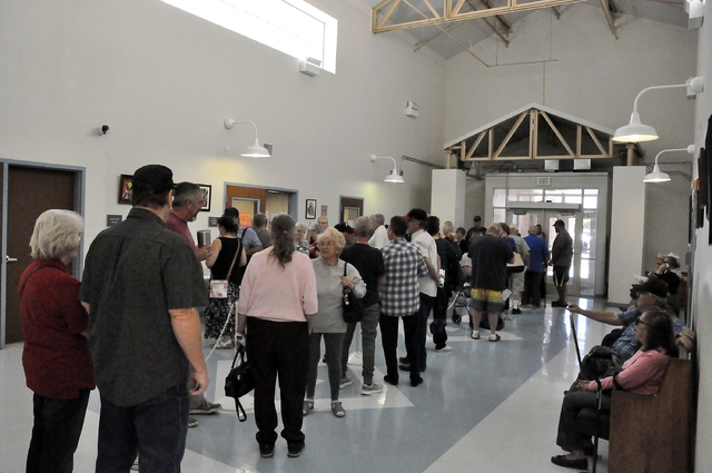 """Voters line up outside of Nye County Clerk's Office at Ian Deutch Justice Complex on the first day of early voting in Pahrump. Nye County Clerk Sandra """"Sam"""" Merlino said the voting process on the  ..."""