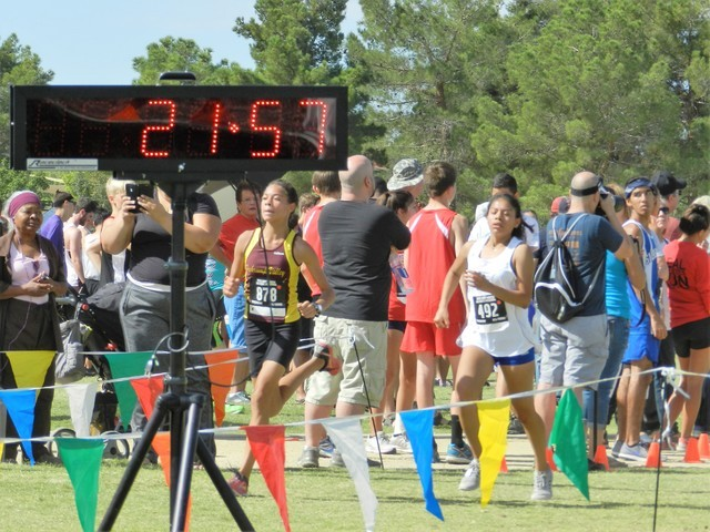 Special to the Pahrump Valley Times  Diamond Sonerholm crosses the finish line at the Larry Burgess Invitational last Saturday. The freshman runner took second place at the four-school meet at Che ...