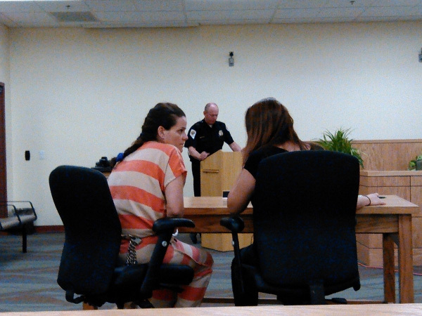Selwyn Harris / Pahrump Valley Times Pahrump resident Maria Furtado, left, conferring with her legal counsel, accpeted a guilty plea agreement for her involvment in the shooting death of a pitbull ...