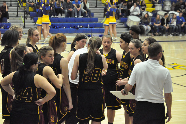 The Lady Trojans take a timeout in the second half, trying to figure out how to score on the Pirates defense.  Vern Hee / Pahrump Valley Times