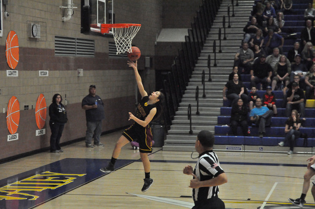 Senior Isabelle Meza makes a layup late in the fourth quarter. This would be her last shot as a Trojans basketball player. She led the team in scoring with seven points during this game.  Vern Hee ...