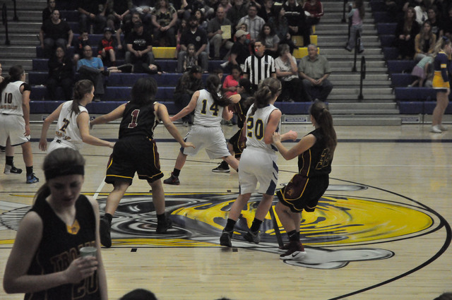 Jessica Turner (1), possible forward, plays late in the fourth quarter during the quarterfinal game against Moapa on Wednesday night.  Vern Hee / Pahrump Valley Times