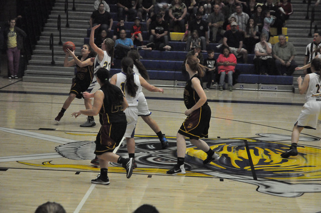 Sophomore Virginia Weir takes a shot during the Trojans playoff game on Wednesday. Weir could be a possible varsity guard next year.  Vern Hee / Pahrump Valley Times