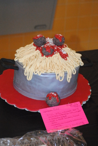 Charlotte Uyeno / Pahrump Valley Times The spaghetti cake at this years cake auction at the Trojans football spaghetti dinner on Aug. 13. This auction brings in every year over $1,000 to the progr ...