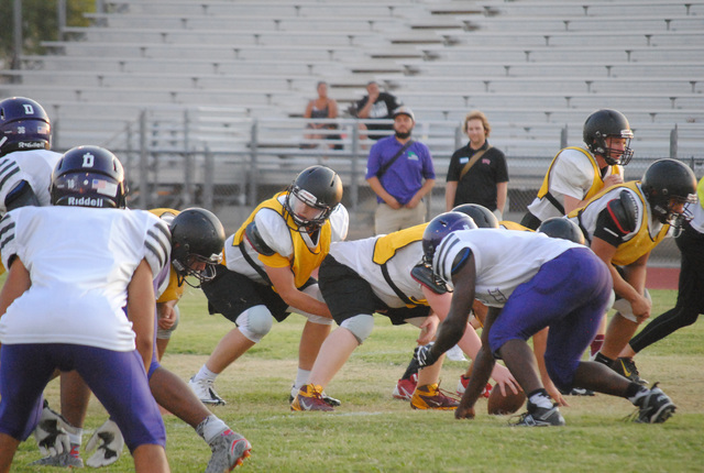Charlotte Uyeno / Pahrump Valley Times Parker Hart gets ready to take a snap during the Trojans scrimmage with Durango High School.