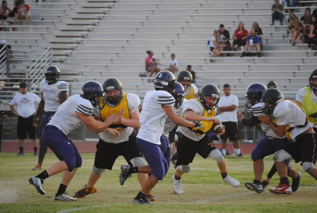 Charlotte Uyeno / Pahrump Valley Times The Trojans run the ball against Durango. Joe Clayton will bring back the running game to Pahrump with his jett sweep offense.